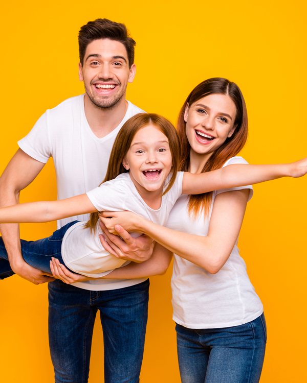 Photo of three family members spending leisure time playing games wear casual outfit isolated yellow background